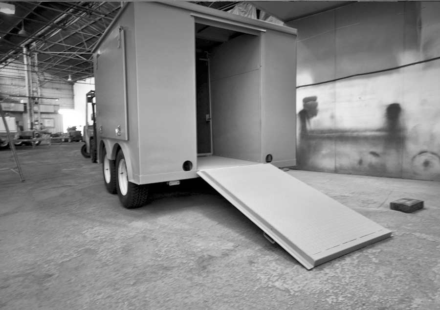 Van style tandem trailer with swing out side doors and a rear ramp